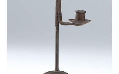 A Wrought Iron Rush Light Candle Holder