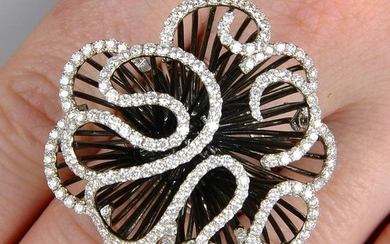 A diamond abstract floral dress ring. Total diamond