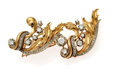 NOT SOLD. A diamond brooch set with numerous diamonds, mounted in 18k gold and white...