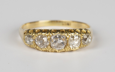 A gold and diamond five stone ring, mounted with a row of graduated cushion cut diamonds, the mount