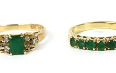 A gold emerald and diamond ring