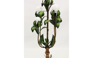 A hardwood and painted metal floor standing lamp in the form...