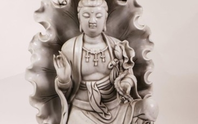 A large Chinese blanc de chine figure of Quan Yin seated wit...
