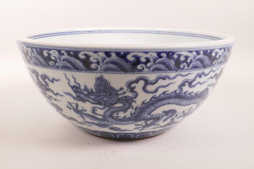 A large Chinese blue and white porcelain bowl decorated with...