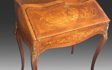 A late 19th century Rococo style bronze mounted rosewood bureau, richly inlaid with intarsia, front with writing leaf and drawers. H. 95. W. 74. D. 43 cm.