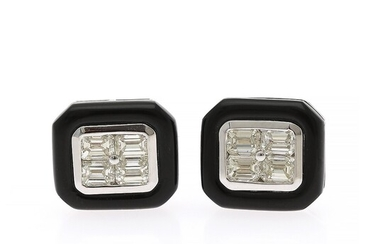 A pair of diamond and onyx ear studs each set with four emerald-cut diamonds encircled by black onyx, mounted in 18k white gold. (2)