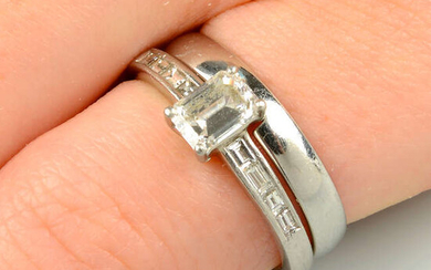 A platinum rectangular-shape diamond single-stone ring, with baguette-cut diamond shoulders and a fitted platinum band ring.