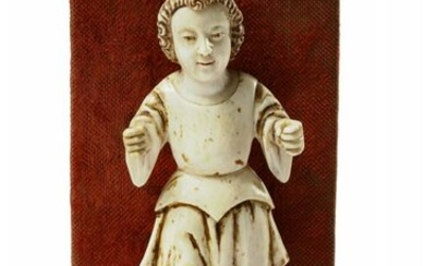 AN INDO-PORTOGUESE IVORY CARVING OF INFANT JESUS AS