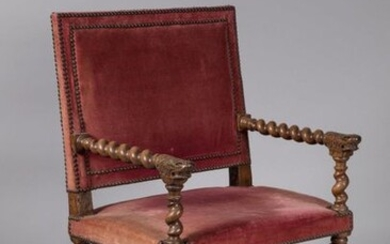 "ARMCHAIR CHAIR with LION MUFLES in turned walnut. The straight back is joined by torsos arms, finished with lion mittens. The armrest supports and the base joined by an ""H"" spacer are also torsos, assembled by square-section connecting thimbles..."