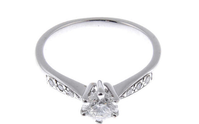An 18ct gold brilliant-cut diamond single-stone ring, with diamond shoulders.