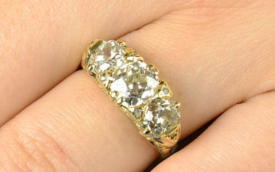 An early 20th century 18ct gold old-cut diamond three-stone ring, with rose-cut diamond accents.