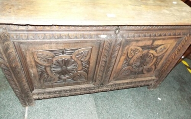 An early Victorian oak three planked top carved panelled cof...