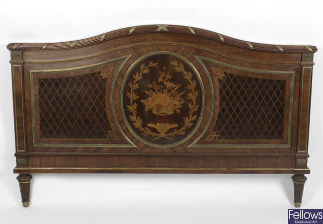 An early twentieth century mahogany marquetry inlaid double bed.