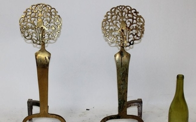 Antique American brass andirons with medallion
