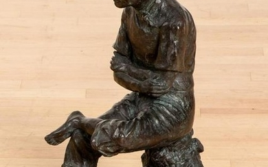 Bronze of a seated young man