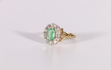 Diamond and emerald oval cluster ring in 18ct gold, 1975. Si...