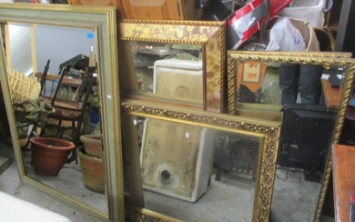 Five mixed gilded wall hanging mirrors to include one having...