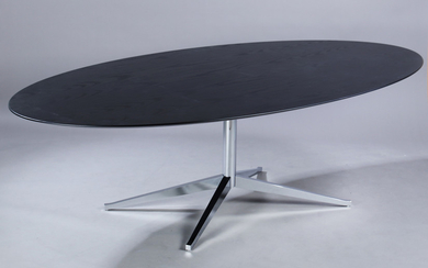 Florence Knoll. Dining table/conference table, oval top in black-glazed wood