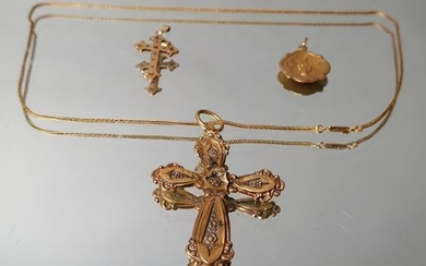 Lot of gold jewelry including, gold cross and...