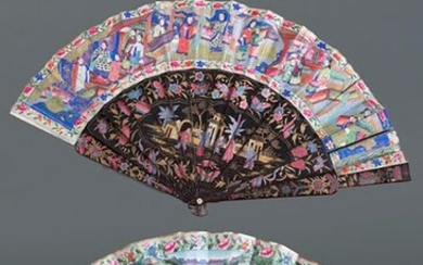 "Lot of two Chinese fans of the so-called ""thousand faces"", c. 1860. Black lacquered rods with vegetable and ""chinoiserie"" decorations and countries with coloured lithographs and ivory applications. Some damage. Longer standard length"