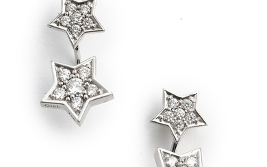 """Ole Lynggaard: A pair of diamond ear studs """"Star"""" with removable pendants set with numerous brilliant-cut diamonds, mounted in 18k white gold."""