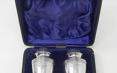 Pair of Edwardian Silver Peppers of Baluster weighted form, ...