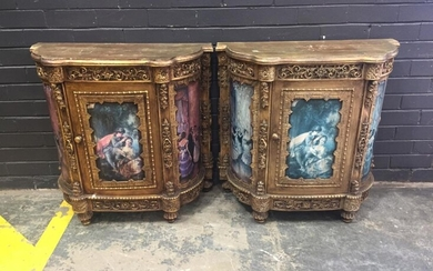 Pair of Gilt French Style Cabinets, each with a single door, with applied scroll decoration & figural panels