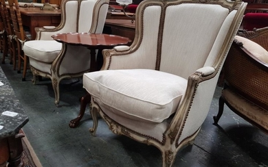 Pair of Louis XV Style Carved & Painted Armchairs, in cream and old gold, upholstered in cream linen & raised on cabriole legs