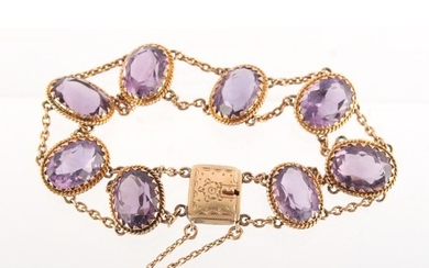 Property of a deceased estate - a 9ct yellow gold amethyst b...