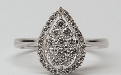 Ring drawing a pear cut plate in white gold, 750 MM, covered with diamonds in a row underlined with diamonds, size 11 / 14 mm, size: 52, weight: 3,65gr. rough.