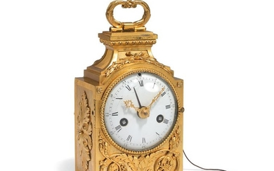 Table clock in gilded bronze, the white enamelled...