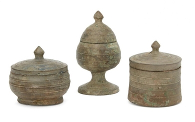 Three Chinese bronze miniature votive covered vessels, Late Six dynasties...