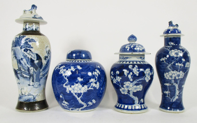 Three blue and white prunus-decorated vases with covers and a crackle ware example
