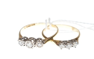 Two diamond three stone rings in 18ct gold. Sizes 'O½...
