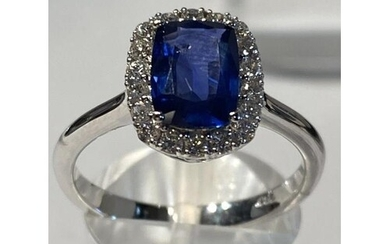 18 Carat White Gold Ceylon Sapphire and Diamond Ring. The n...