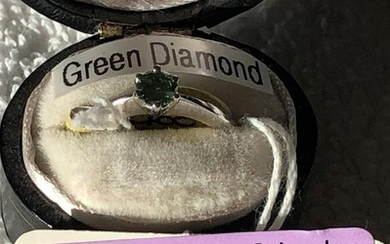 18ct white gold green diamond ring size g 1/2 weighs 2.8g.T...
