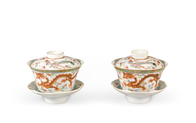 A pair of Chinese famille rose enameled porcelain lidded tea bowls and stands