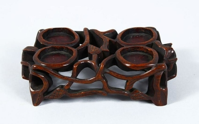 A 19TH CENTURY CHINESE CARVED HARDWOOD STAND, 4cm high