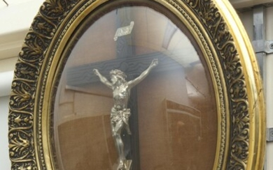 A 19TH CENTURY GILT FRAMED SILVERED BRONZE CRUCIFIX WITH DOME GLASS