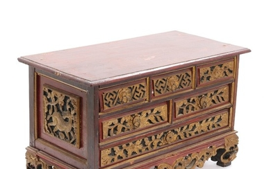 A C. 1900 Chinese miniature chest of partly redpainted and gilt wood. H. 32. W. 50. D. 26 cm.
