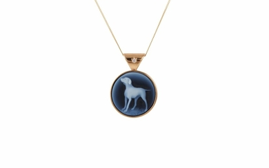 A CIRCULAR PORCELAIN PENDANT, depicting a dog, mounted in ye...