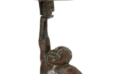A Chinese bronze figural candleholder, Western Han dynasty, cast as...
