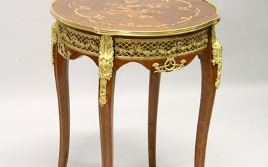 A FRENCH STYLE MARQUETRY AND ORMOLU MOUNTED LAMP TABLE.