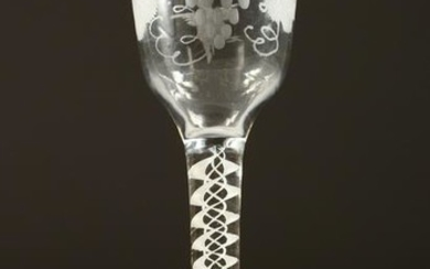 A GEORGIAN WINE GLASS, the bowl engraved with fruiting