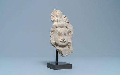 A Khmer stone fragment of an Apsara, Cambodia, Bayon, 10/12th C.