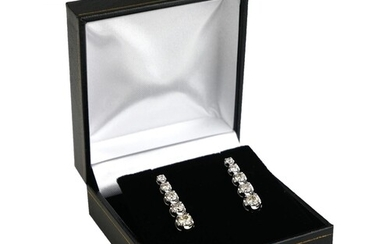 A PAIR OF 18CT WHITE GOLD DROP EARRINGS Set with 2ct of gra...