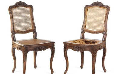 A Pair of Louis XV Carved Walnut Side Chairs