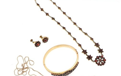 SOLD. A garnet jewellery set of silver, 8k and 14k gold and metal comprising two...