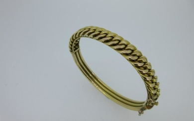 A hinged bangle with fixed chain link front stamped