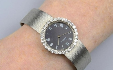 A lady's 18ct gold wrist watch, with black dial and